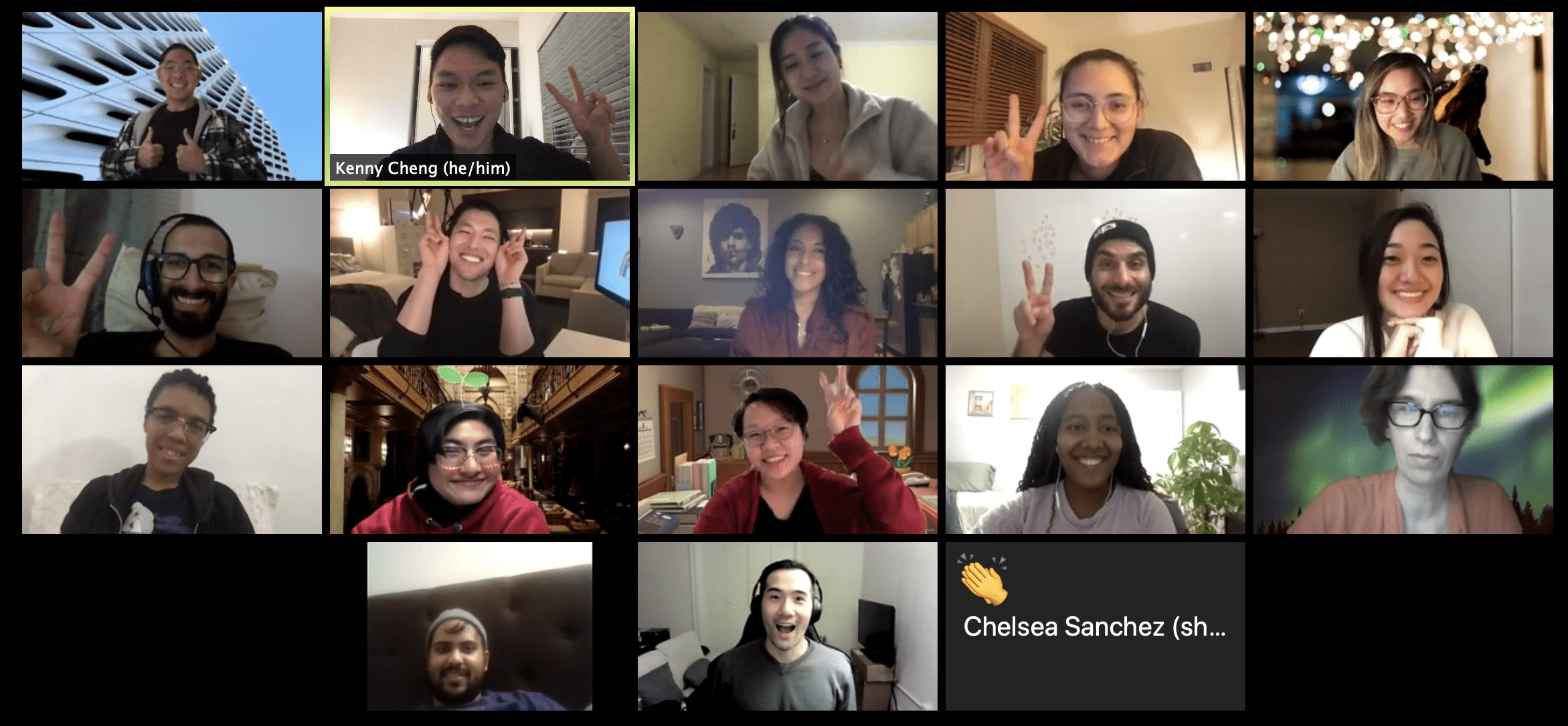 Grid of 18 people in a video call, many holding up their hands with peace signs.